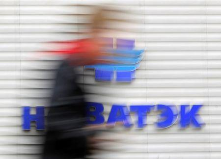 A man passes the sales office of Novatek, Russia's largest independent natural gas producer, in Moscow, in this September 16, 2012 file photo. REUTERS/Maxim Shemetov/Files