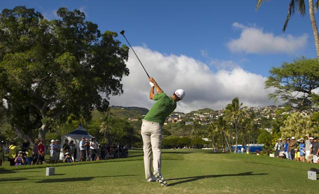 Adam Scott tees off on the 14th hole during the second round of the Sony Open golf tournament, Friday, Jan. 10, 2014, in Honolulu. (AP Photo/Marco Garcia)