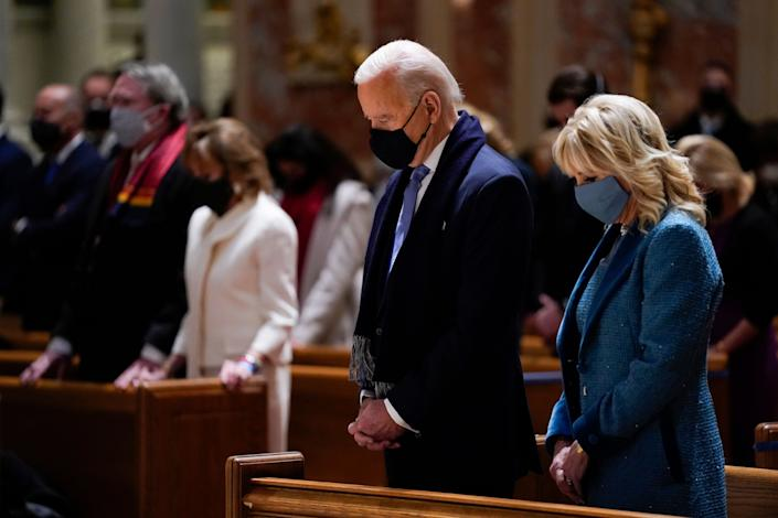 President-elect Joe Biden and his wife, Jill Biden, attend Mass at the Cathedral of St. Matthew the Apostle in Washington before his inauguration Wednesday. (Photo: Evan Vucci/ASSOCIATED PRESS)