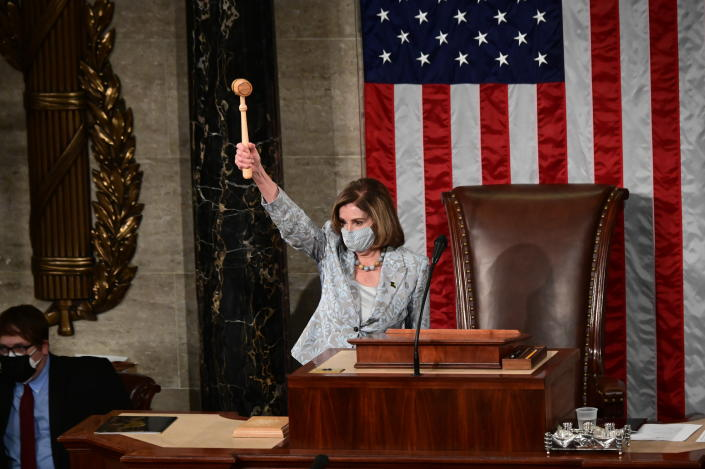 Speaker of the House Nancy Pelosi of Calif., waves the gavel on the opening day of the 117th Congress on Capitol Hill in Washington, Sunday, Jan. 3, 2021. (Erin Scott/Pool via AP)