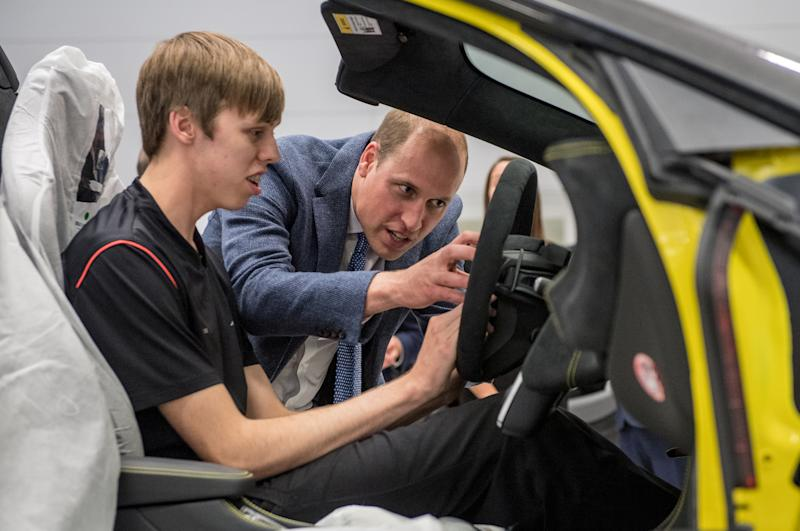 Britain's Prince William, helps fit an airbag to a McLaren car with apprentice of the year nominee, Alex Machin on the factory floor during his visit to McLaren Automotive Production Centre in Woking, September 12, 2017. REUTERS/Chris J. Ratcliffe/Pool