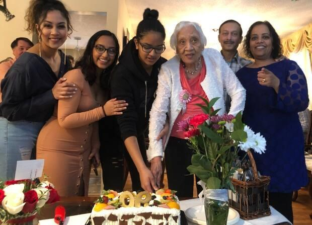 Naomi Charles, pictured here with her family on her 90th birthday, was diagnosed with COVID-19 in April 2020. She recovered from the infection but endured several care home lockdowns. She died on Feb. 22, 2021.