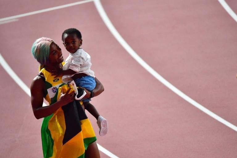 Shelly-Ann Fraser said after winning her fourth 100 metres world title it has been a long journey mentally and physically coming back after the birth of her son Zyon (AFP Photo/Giuseppe CACACE)