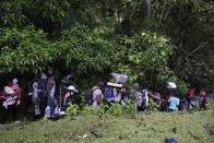 Migrants continue their trek north, near Acandi, Colombia, Wednesday, Sept. 15, 2021. The migrants, mostly Haitians, are on their way to crossing the Darien Gap from Colombia into Panama dreaming of reaching the U.S. (AP Photo/Fernando Vergara)
