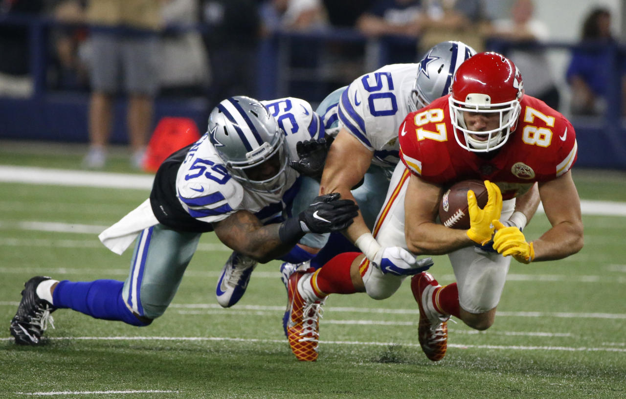 <p>Dallas Cowboys' Anthony Hitchens (59) and Sean Lee (50) combine to stop Kansas City Chiefs' Travis Kelce from advancing the ball after catching a pass in the second half of an NFL football game, Sunday, Nov. 5, 2017, in Arlington, Texas. (AP Photo/Michael Ainsworth) </p>