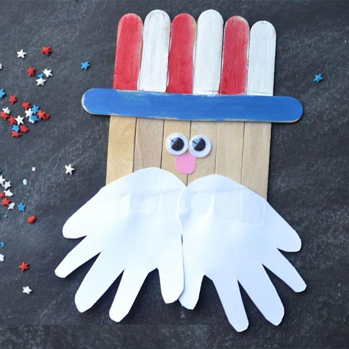"""<p>Little hands make the perfect mustache for this simple Popsicle stick Uncle Sam craft. </p><p><em><strong>Get the tutorial from <a href=""""https://www.gluedtomycraftsblog.com/2015/05/popsicle-stick-uncle-sam-kid-craft.html"""" rel=""""nofollow noopener"""" target=""""_blank"""" data-ylk=""""slk:Glued to My Crafts Blog"""" class=""""link rapid-noclick-resp"""">Glued to My Crafts Blog</a>.</strong></em> </p>"""