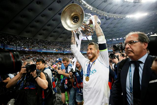 Soccer Football - Champions League Final - Real Madrid v Liverpool - NSC Olympic Stadium, Kiev, Ukraine - May 26, 2018 Real Madrid's Sergio Ramos celebrates with the trophy after winning the Champions League REUTERS/Gleb Garanich