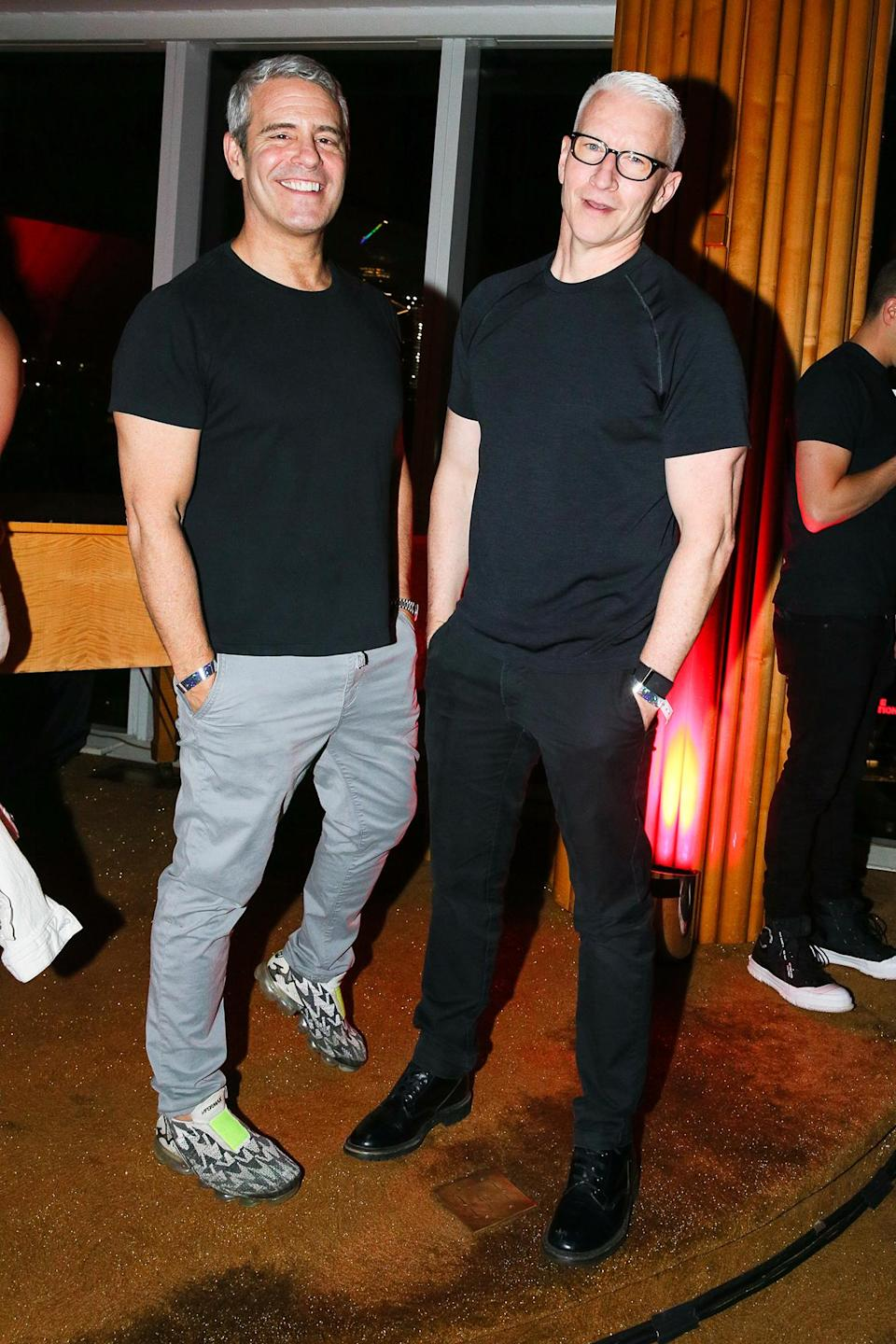 <p>Andy Cohen and Anderson Cooper strike matching poses at The Standard High Line's New York Pride Kick-Off Party on June 24 in N.Y.C. </p>