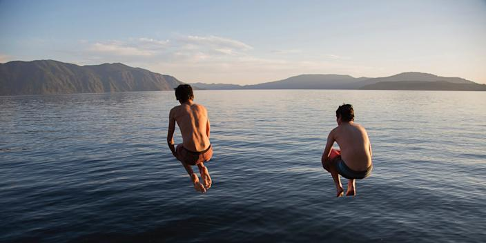 Boys jumping into lake from dock (File photo).