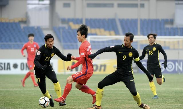 South Korea needed a late winner from star midfielder Han Seung-gyu to deny Malaysia a semifinal place after a heroic display from the Young Tigers.