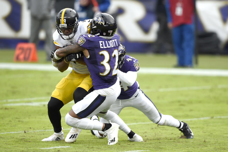 Pittsburgh Steelers wide receiver JuJu Smith-Schuster, left, is stopped short of the goal line by Baltimore Ravens free safety DeShon Elliott (32) and cornerback Marlon Humphrey during the second half of an NFL football game, Sunday, Nov. 1, 2020, in Baltimore. (AP Photo/Gail Burton)