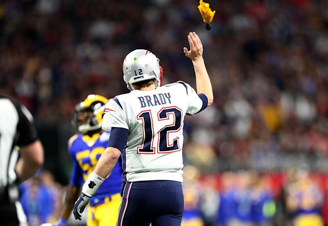 <p>Tom Brady #12 of the New England Patriots reacts in the first quarter against the Los Angeles Rams during Super Bowl LIII at Mercedes-Benz Stadium on February 03, 2019 in Atlanta, Georgia. (Photo by Maddie Meyer/Getty Images) </p>