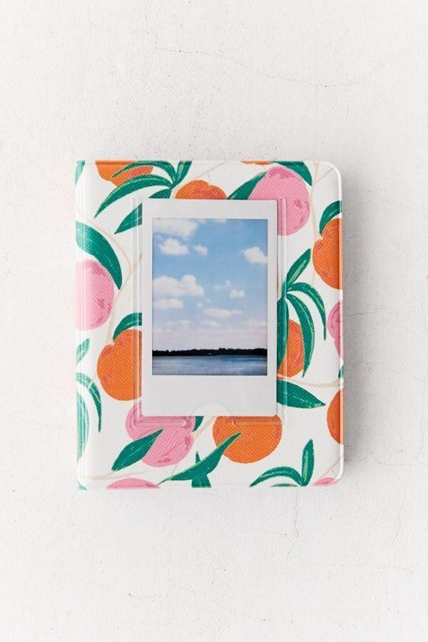"They'll need somewhere to put all those photos of them hanging out indoors. Get it for $14 at <a href=""https://www.urbanoutfitters.com/en-ca/shop/instax-patterned-photo-album-001"" target=""_blank"" rel=""noopener noreferrer"">Urban Outfitters</a>."