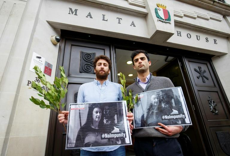 Matthew Caruana Galizia (L) and Paul Caruana Galizia, the sons of murdered Maltese journalist Daphne Caruana Galizia, attended a vigil in London on Thursday to mark the six-month anniversary of the killing