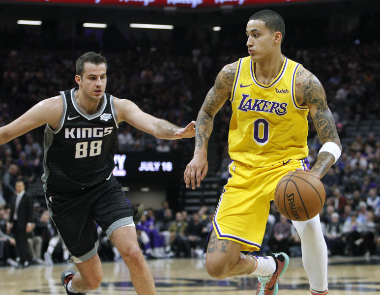 Los Angeles Lakers forward Kyle Kuzma drives around Sacramento Kings forward Nemanja Bjelica during the first half of an NBA basketball game in Sacramento Calif. Thursday Dec. 27 2018