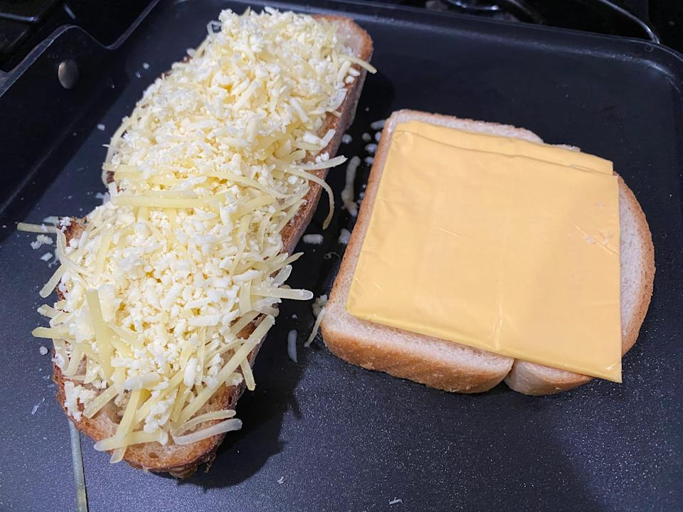 a slide of country loaf with shredded cheese and a slice of white bread with american slices