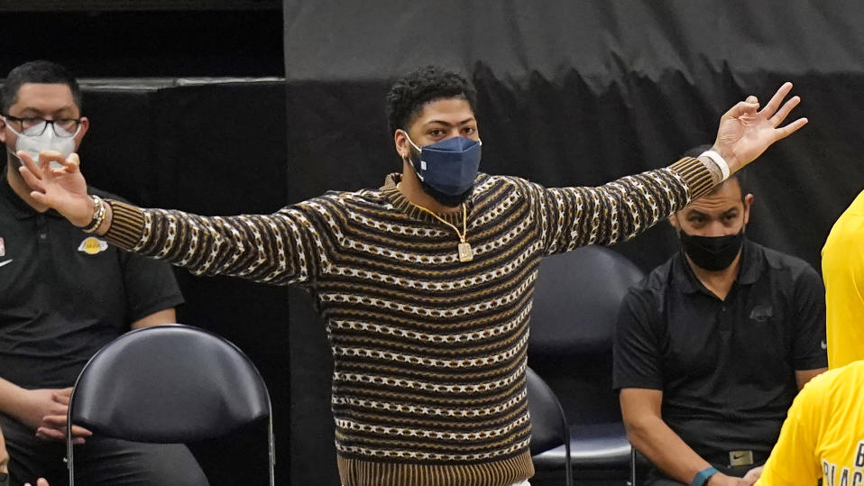 Los Angeles Lakers forward Anthony Davis gestures while watching the second half of the team's NBA basketball game against the Utah Jazz on Wednesday, Feb. 24, 2021, in Salt Lake City. (AP Photo/Rick Bowmer)