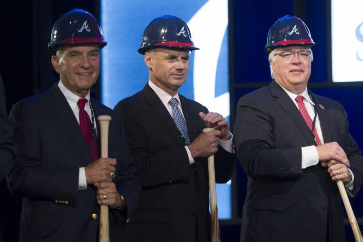 Baseball Commissioner Elect Rob Manfred, center, is seen with Atlanta Braves President John Schuerholz, left, and Cobb County Chairman Tim Lee, right, during a ground breaking ceremony for the Atlanta Braves new stadium which will be called SunTrust Park, Tuesday, Sept. 16, 2014, in Atlanta. The Braves will be moving from Turner Field in Fulton County to the new stadium being built in Cobb County in 2017. (AP Photo/John Amis)