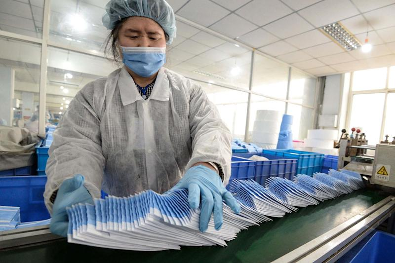 A worker producing face masks at a factory in Handan in China's northern Hebei province (AFP via Getty Images)