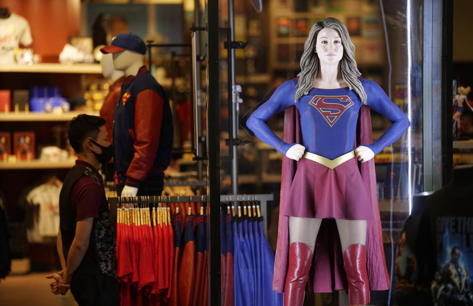 An authentic Supergirl costume is displayed behind glass at the new Warner Bros. Studio Store during the Warner Bros. Studio Tour Hollywood media preview on June 24, 2021, in Burbank, Calif. (AP Photo/Chris Pizzello)