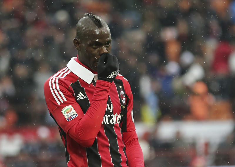 AC Milan forward Mario Balotelli gestures after scoring during the Serie A soccer match between AC Milan and Palermo at the San Siro stadium in Milan, Italy, Sunday, March 17, 2013. (AP Photo/Antonio Calanni)