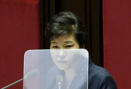 FILE PHOTO: South Korean President Park Geun-hye delivers her speech during a plenary session at the National Assembly in Seoul