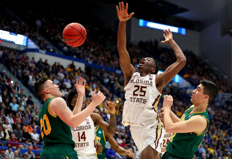 <p>Mfiondu Kabengele #25 of the Florida State Seminoles plays against Ernie Duncan #20 of the Vermont Catamounts during their first round game of the 2019 NCAA Men's Basketball Tournament at XL Center on March 21, 2019 in Hartford, Connecticut. The Seminoles won the game 76-69. (Photo by Maddie Meyer/Getty Images) </p>