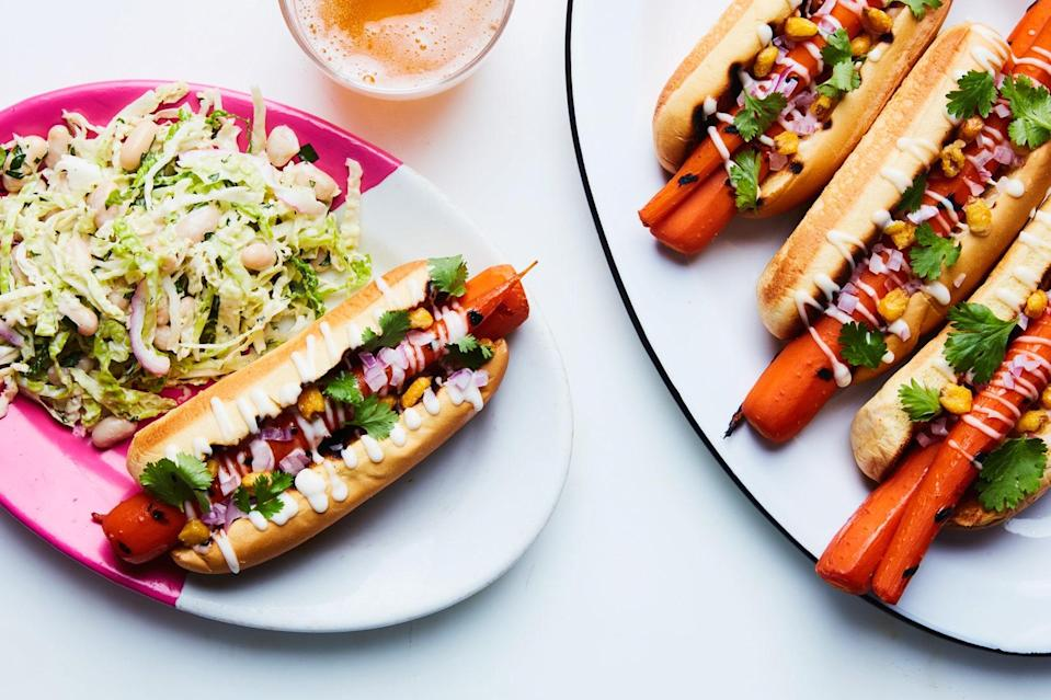 "The carrots in this dish get sweet umami and heat from maple syrup and adobo sauce. They're just as good alongside other dishes as they are piled into a bun for a vegetarian take on the hot dog. <a href=""https://www.epicurious.com/recipes/food/views/grilled-carrot-hot-dogs-with-creamy-slaw?mbid=synd_yahoo_rss"" rel=""nofollow noopener"" target=""_blank"" data-ylk=""slk:See recipe."" class=""link rapid-noclick-resp"">See recipe.</a>"