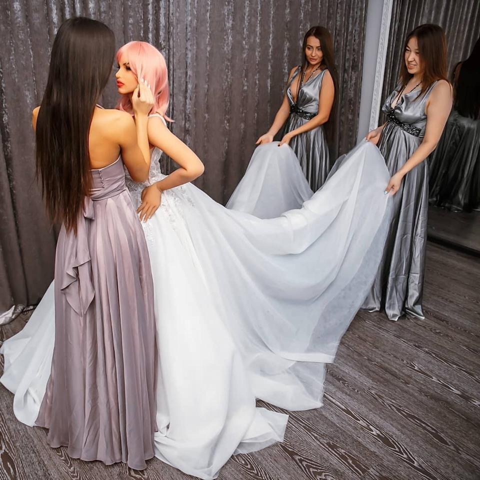 Sex doll Margot wedding dress shopping with her bridal party.