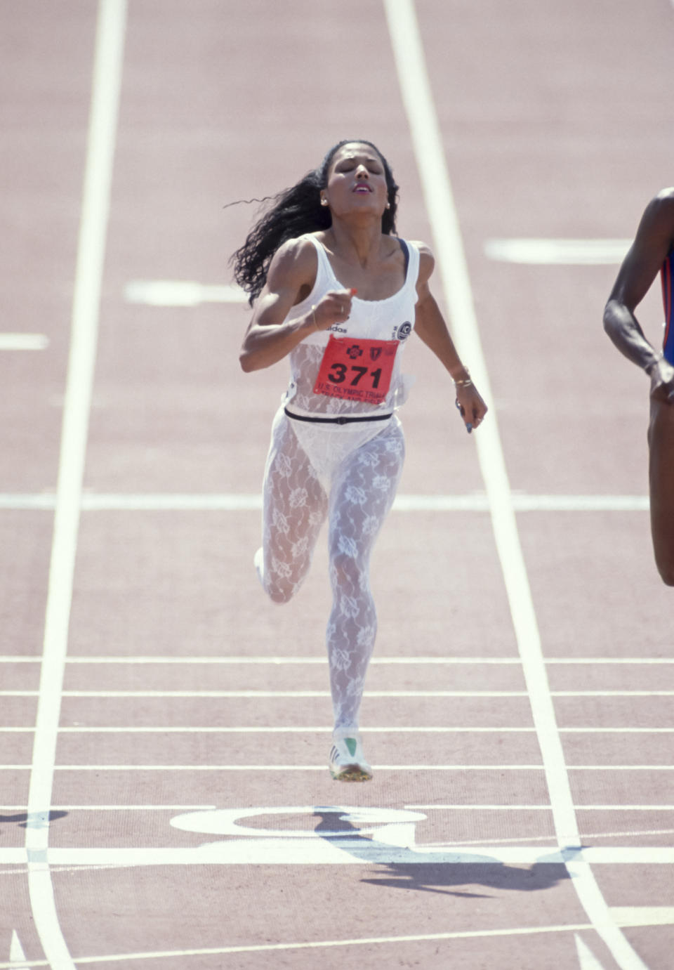 INDIANAPOLIS, IN - JULY 23:  Florence Griffith Joyner #371 of the USA competes in the final of the Women's 200 meter race of the 1988 USA Track and Field Olympic Trials held July 22, 1988 at the IU Michael A. Carroll Track & Soccer Stadium in Indianapolis, Indiana.  (Photo by David Madison/Getty Images)