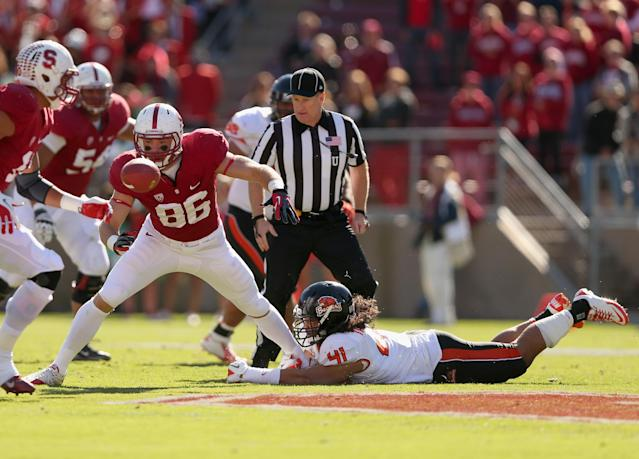 STANFORD, CA - NOVEMBER 10: Zach Ertz #86 of the Stanford Cardinal fumbles the ball after being hit by Feti Taumoepeau #41 of the Oregon State Beavers at Stanford Stadium on November 10, 2012 in Stanford, California. (Photo by Ezra Shaw/Getty Images)