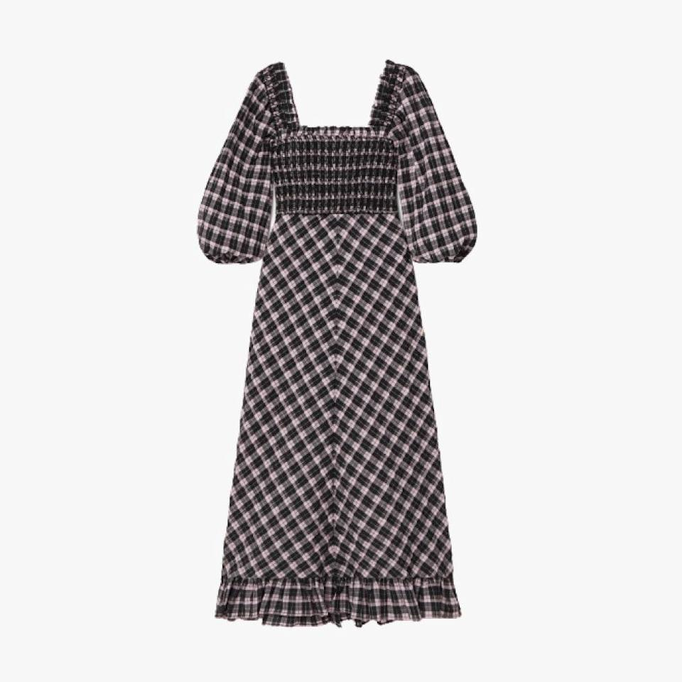 """This fall take on a summer staple by Ganni will be an easy go-to with all your boots. $295, NET-A-PORTER. <a href=""""https://www.net-a-porter.com/en-us/shop/product/ganni/smocked-checked-cotton-blend-seersucker-midi-dress/1271988"""" rel=""""nofollow noopener"""" target=""""_blank"""" data-ylk=""""slk:Get it now!"""" class=""""link rapid-noclick-resp"""">Get it now!</a>"""