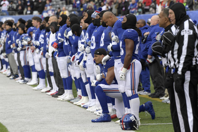 New York Giants defensive end Olivier Vernon kneels during the national anthem before last year's season finale. (AP)