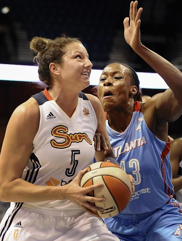 Connecticut Sun's Kelsey Griffin, left, is pressured by Atlanta Dream's Le'coe Willingham during the first half of a WNBA basketball game in Uncasville, Conn., Wednesday, Aug. 14, 2013. (AP Photo/Jessica Hill)
