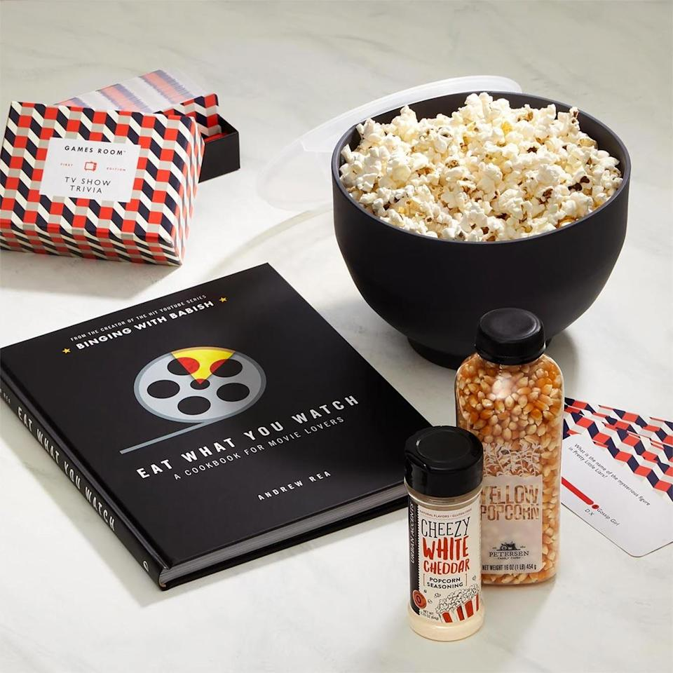 """<p>Mix up your TV binge and movie date nights with this <a href=""""https://knackshops.com/products/movies-and-popcorn-gift-set"""" rel=""""nofollow noopener"""" target=""""_blank"""" data-ylk=""""slk:beautiful gift box"""" class=""""link rapid-noclick-resp"""">beautiful gift box</a> from Knack. Every pop culture lover in your life will swoon for this kit complete with do-it-yourself popcorn, a cookbook filled with recipes from your favorite films, and a trivia game that will put your TV knowledge to the test.</p> <p><strong>$85, <a href=""""https://knackshops.com/products/movies-and-popcorn-gift-set"""" rel=""""nofollow noopener"""" target=""""_blank"""" data-ylk=""""slk:knackshops.com"""" class=""""link rapid-noclick-resp"""">knackshops.com</a></strong></p> <p><strong>*Use FIRST10 to save $10 on your first Knack gift order</strong></p>"""
