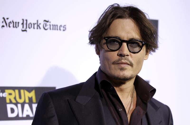 """Cast member Johnny Depp arrives at the premiere of """"The Rum Diary"""" in Los Angeles, Thursday, Oct. 13, 2011. """"The Rum Diary"""" opens in theaters Oct. 28, 2011. (AP Photo/Matt Sayles)"""