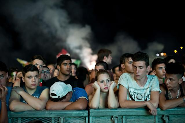 ROME, ITALY - JULY 01: Italian fans react as they watch the UEFA EURO 2012 final match between Italy and Spain on a big screen at the Circus Maximo on July 1, 2012 in Rome, Italy. (Photo by Giorgio Cosulich/Getty Images)
