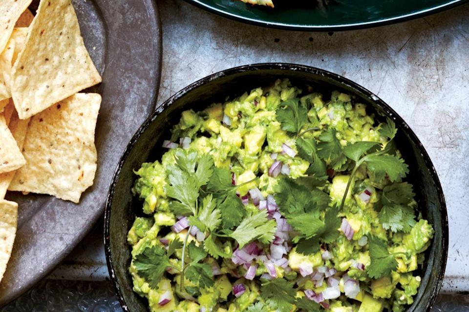 """Guacamole meets crunchy celery in this refreshing take on the classic. <a href=""""https://www.epicurious.com/recipes/food/views/celery-spiked-guacamole-with-chiles-51214860?mbid=synd_yahoo_rss"""" rel=""""nofollow noopener"""" target=""""_blank"""" data-ylk=""""slk:See recipe."""" class=""""link rapid-noclick-resp"""">See recipe.</a>"""