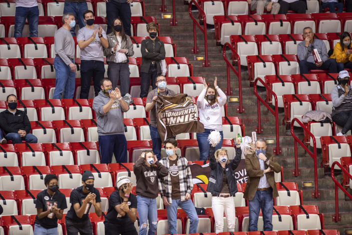 St. Bonaventure fans cheer for the team during the second half of a first round game against LSU in the NCAA men's college basketball tournament, Saturday, March 20, 2021, at Assembly Hall in Bloomington, Ind. (AP Photo/Doug McSchooler)