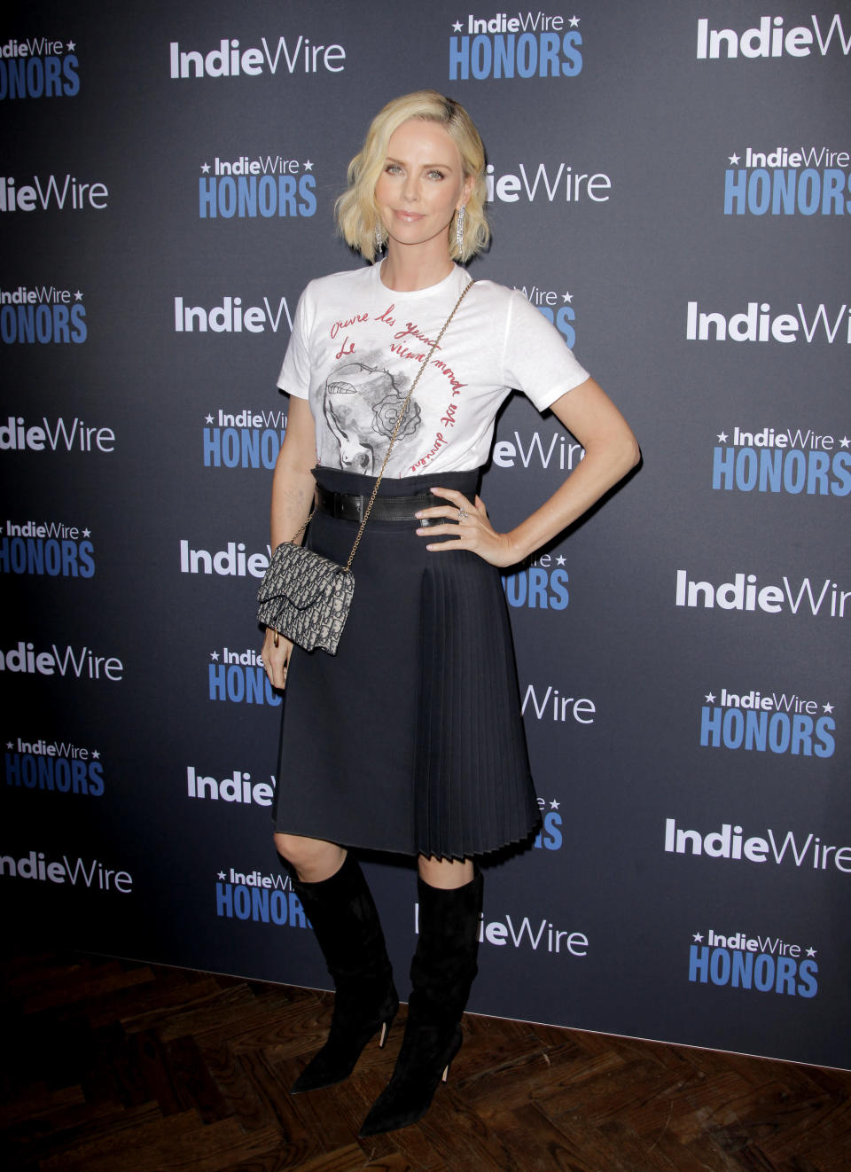 <p>The South African born star opted for a slightly more casual look than fellow attendee Natalie Portman, in a tee and skirt combo by French fashion house Dior. <em>[Photo: Getty]</em> </p>