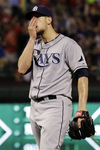 Tampa Bay Rays starting pitcher James Shields covers his face after giving up a solo home run to Texas Rangers' Ian Kinsler in the fourth inning of a baseball game, Tuesday, Aug. 28, 2012, in Arlington, Texas. (AP Photo/Tony Gutierrez)
