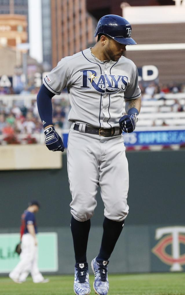Tampa Bay Rays' Tommy Pham hops sideways before touching the plate on his solo home run off Minnesota Twins pitcher Jake Odorizzi to tie score during the sixth inning against the Minnesota Twins in a baseball game Wednesday, June 26, 2019, in Minneapolis. (AP Photo/Jim Mone)