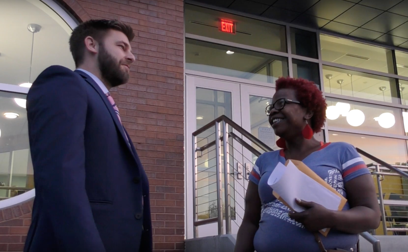 Angelia Bradley and her lawyer, Nathaniel Carroll, stand outside Ferguson's Municipal Court building. Bradley performed community service in lieu of fines she faced for various traffic tickets. (HuffPost)