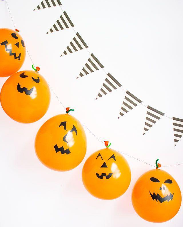 """<p>Draw funny faces on orange balloons and string them together for a fast and fun garland. </p><p><a class=""""link rapid-noclick-resp"""" href=""""https://www.amazon.com/PartyMate-71984-Balloons-50-Count-Bright/dp/B002E6I4X8/?tag=syn-yahoo-20&ascsubtag=%5Bartid%7C10055.g.421%5Bsrc%7Cyahoo-us"""" rel=""""nofollow noopener"""" target=""""_blank"""" data-ylk=""""slk:SHOP ORANGE BALLOONS"""">SHOP ORANGE BALLOONS</a></p><p><em><a href=""""https://designimprovised.com/2016/10/simple-pumpkin-balloons.html"""" rel=""""nofollow noopener"""" target=""""_blank"""" data-ylk=""""slk:Get the tutorial at Design Improvised »"""" class=""""link rapid-noclick-resp"""">Get the tutorial at Design Improvised »</a></em></p>"""