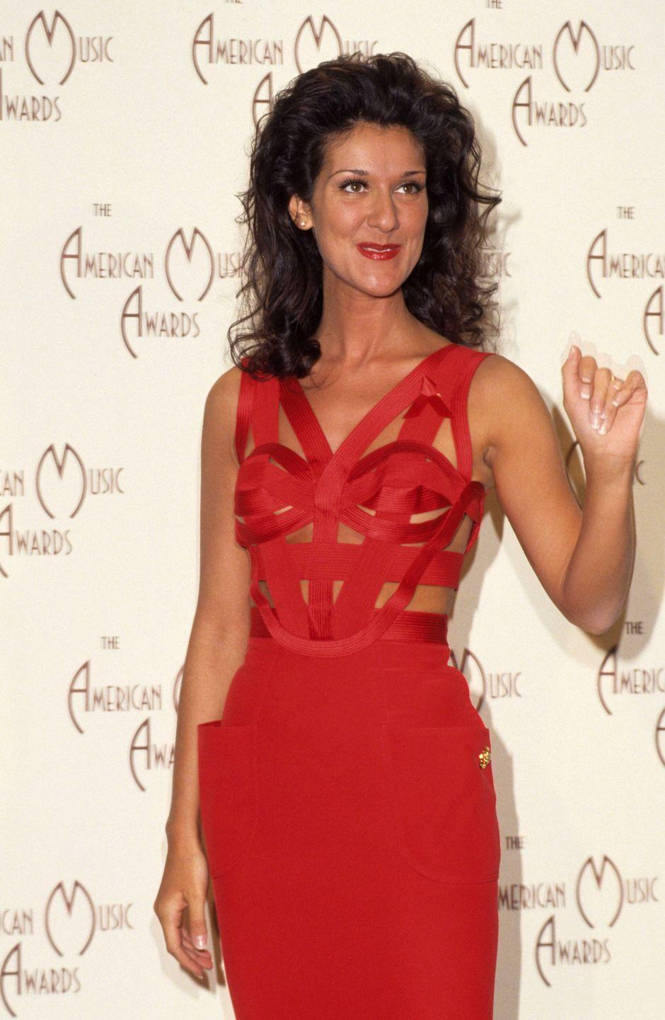 <p>Celine stuns in a sexy red bandage dress for the American Music Awards. She kept her accessories minimalist, so all eyes were on her gown. </p>