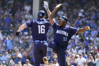 Chicago Cubs' Patrick Wisdom, left, celebrates with third base coach Willie Harris as he rounds the bases after hitting a solo home run in the second inning of a baseball game against the Kansas City Royals, Friday, Aug. 20, 2021, in Chicago. (AP Photo/Nam Y. Huh)