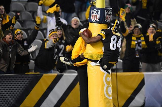 Antonio Brown puts on a show during and after the play. (Getty)