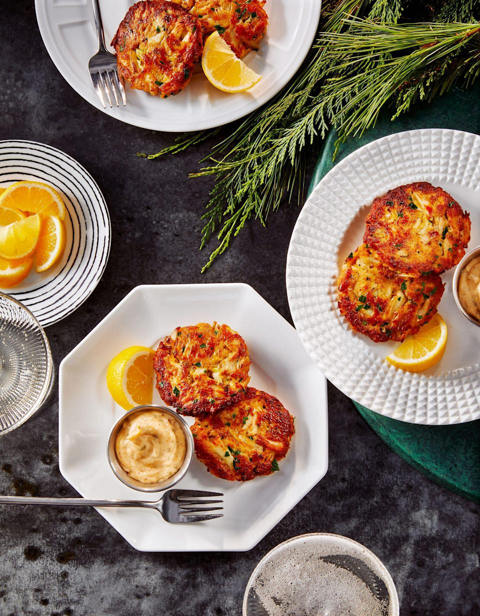 """<p><strong>Recipe:</strong> <a href=""""https://www.southernliving.com/recipes/crab-cake-bites"""" rel=""""nofollow noopener"""" target=""""_blank"""" data-ylk=""""slk:Crab Cake Bites with Old Bay Mayo, Chives, and Lemon"""" class=""""link rapid-noclick-resp"""">Crab Cake Bites with Old Bay Mayo, Chives, and Lemon</a></p> <p>These crab bites are all meat and no binders so the crab really shines through. Whatever you do, don't skip out on that Old Bay Mayo, it's the magic sauce to this dish.</p>"""