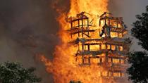 <p>Fire engulfs a 16-story wooden tower at Jiulong Town on December 10, 2017 in Deyang, Sichuan Province of China. A huge blaze has engulfed and destroyed a 16-story wooden tower, known as the tallest of its kind in Asia, after a fire, starting at the Lingguan Mansion, raged through a monastery in Sichuan Province, southwest China. (VCG/VCG via Getty Images) </p>