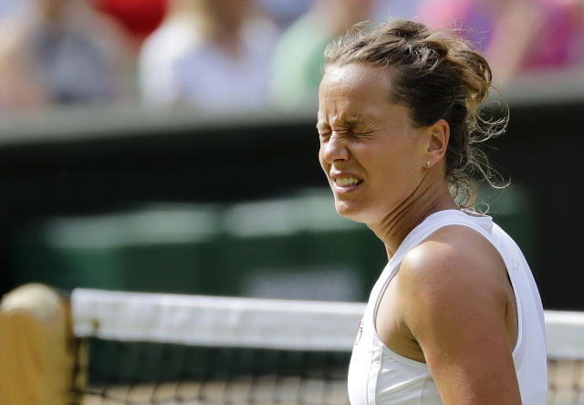 Czech Republic's Barbora Strycova reacts as she plays United States' Serena Williams in a Women's semifinal singles match on day ten of the Wimbledon Tennis Championships in London, Thursday, July 11, 2019. (AP Photo/Ben Curtis)